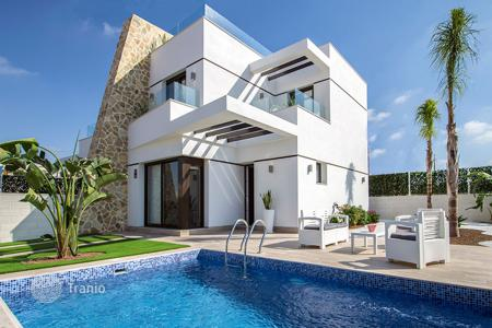 Cheap townhouses for sale in Spain. Modern Semi-Detached Villas in Orihuela Costa