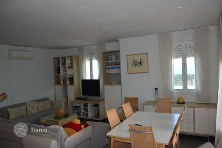 Penthouses for sale in Spain. Three levels apartment in Denia, Spain. House with garden in front of the sea