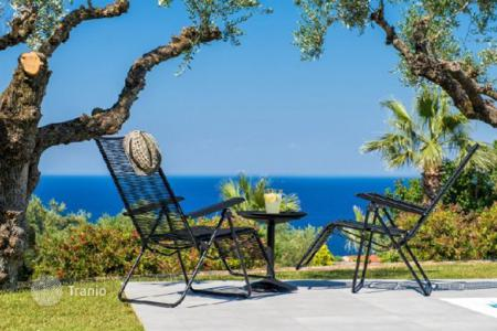 Villas and houses for rent with swimming pools in Administration of the Peloponnese, Western Greece and the Ionian Islands. This elegant villa with exceptional sea and grasseland views is found in a prime area of Zakynthos island. It is set onl