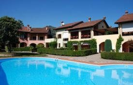 3 bedroom apartments for sale in Italy. Duplex apartment with terrace in a complex of townhouses with a swimming pool, a few steps from the lake, in Lesa, Italy