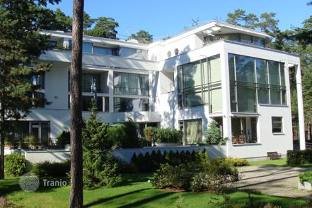 Luxury property for sale in Latvia. Furnished apartment with a balcony and a view of the forest, with a pool, baths, and a gym, near the sea, Jurmala, Latvia