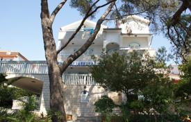 Beach villa with a private garden, a garage, a mooring for a boat and sea view, Šibenik, Croatia for 890,000 €