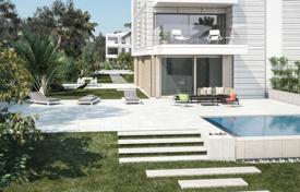 Luxury houses with pools for sale in Costa del Garraf. Beachfront cottage with a swimming pool in a residential complex with green areas and a lake, Gavà Mar, Spain