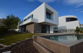 Houses with pools for sale in Finestrat. New three-level villa in Finestrat, Alicante, Spain