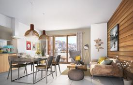 4 bedroom apartments for sale in Auvergne-Rhône-Alpes. Penthouse with a balcony, in a new residence, in a popular ski resort, 150 meters from the cable car, Isère, France