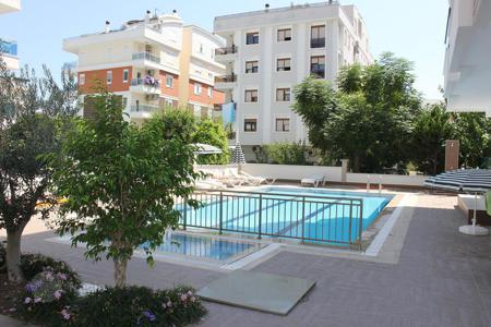 2 bedroom apartments from developers for sale overseas. New apartment in сomplex with parking, swimming pool and fitness center, near to the sea, in the prestigious area of ​​Antalya