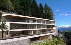 Luxury 3 bedroom apartments for sale in Central Europe. Modern apartment in a new house with a terrace, a garden and views of the mountains and Lake Maggiore, Brione, Switzerland