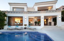 Luxury houses with pools for sale in Balearic Islands. Furnished villa with a private garden, a pool, terraces, a garage and sea views, Santa Ponsa, Spain
