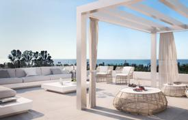 4 bedroom apartments for sale in Southern Europe. Luxury apartment with a terrace and a view of the garden in a new residence with a swimming pool, 100 meters from the sea, Málaga, Spain