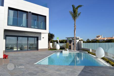 Houses for sale in Dehesa de Campoamor. Modern detached villa with private pool and sea views in Campoamor