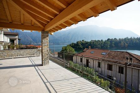 Houses with pools for sale in Lombardy. Ossuccio: Nearing completion a detached lake front villa few metres from the lake shore with beautiful extensive lake views!