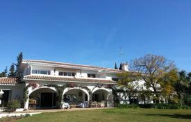 Spacious villa with a private garden, a swimming pool, tennis courts, garages and terraces, Calahonda, Spain for 2,100,000 €