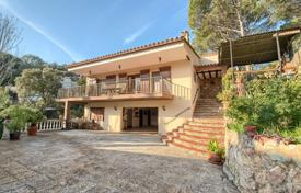 Houses for sale in Sa Riera. Two-storey Mediterranean-style villa with a terrace and a barbecue area, a few steps from the beach of Sa Riera, Spain