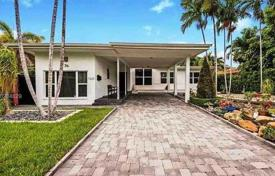 Residential for sale in North America. One-level house with a pier on the bank of the channel in Miami Beach, Florida, USA