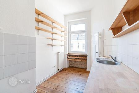 Cheap new homes for sale in Berlin. Renovated apartment with a balcony in a historic building in the Berlin, district of Neukölln