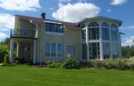 Houses for sale in Finland. Luxury villa with a terrace, balconies and a picturesque garden, on the shore of Päijänne Lake, Jyväskylä, Finland