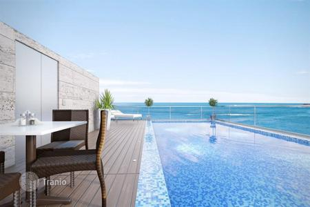 Luxury apartments for sale in Israel. Penthouse with terrace and swimming pool, in a new residence, in front of the sea, in Netanya, Israel