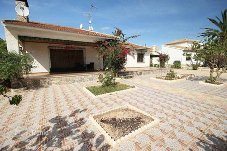 4 bedroom houses by the sea for sale in Spain. Spacious villa with a swimming pool and a terrace, Campoamor, Spain