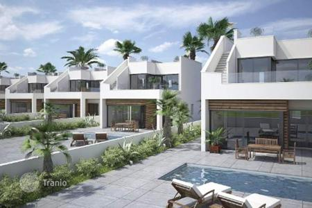 3 bedroom houses for sale in Murcia. 3 bedroom modern villas with private pool, garden, and solarium with sea views in a golf resort in Pilar de la Horadada