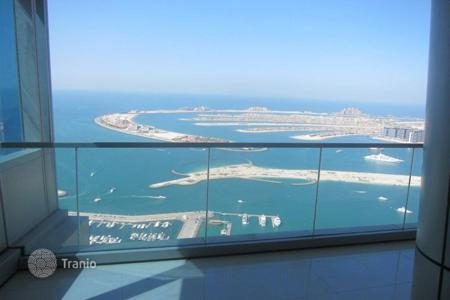 2 bedroom apartments for sale in Western Asia. Modern apartment with furniture and stunning views of the sea and the palm island near Dubai Marina