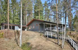 Houses for sale in Finland. Furnished house with its own pier, boat and view of the lake and the forest, Lahti, Finland