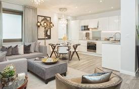 Property for sale in Western Europe. New apartment with a balcony in a gated residence with a gym, an underground parking and a landscaped garden, London, UK