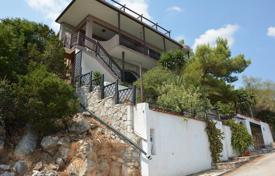 3 bedroom houses by the sea for sale in Korinthos. Three levels villa with panoramic sea view, garden and garage, in Peloponnese, Greece