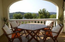 5 bedroom houses for sale in Majorca (Mallorca). Villa with a private garden, a pool, a garage, a terrace and sea and mountain views, Costa de la Calma, Spain