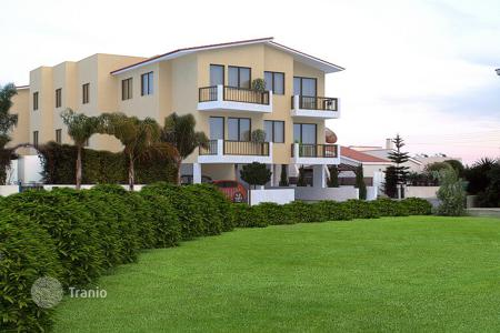 Luxury houses with pools for sale in Kissonerga. Building with eight apartment and a three bedroom detached house