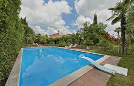 Houses with pools for sale in Italy. Exclusive villa with a large garden and swimming pool in a beautiful residential area, north of the center of Rome