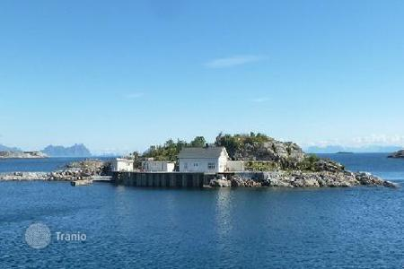 Islands for sale in Norway. The island with a residential house and a pier in Lofoten, Northern Norway