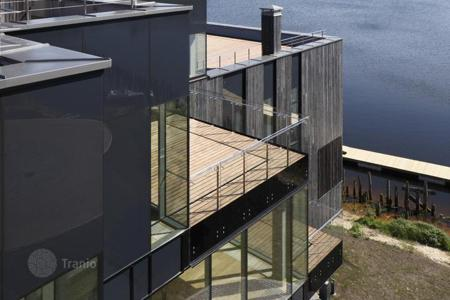 Apartments with pools for sale in Riga. Apartment fully completed, by the lake, in Adazi, Riga suburb