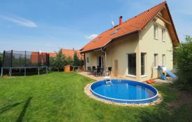 Houses for sale in Central Bohemia. Wooden cottage with a garden, a pool and a garage, Roztoky, Czech Republic