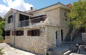 Coastal houses for sale in Split-Dalmatia County. Villa with a private garden, a parking, terraces and a sea view, Brac, Croatia