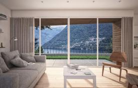 Two-level apartment with views of the lake and the mountains, a jacuzzi and a garage in a modern residence, Carate Urio, Italy for 730,000 €