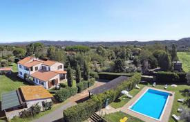 Luxury houses for sale in Italy. Two-storey villa with a vineyard and an olive plantation in Castagneto Carducci, Tuscany, Italy