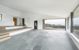 Houses for sale in Catalonia. Modern house with a terrace, a garden and sea views in close proximity to Cadaques, Spain