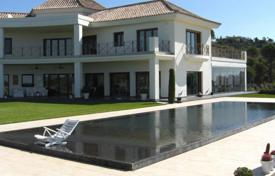 Luxury 6 bedroom houses for sale in Malaga. Modern villa with a panoramic view of the coast, in Benahavís, Spain. House with a swimming pool, a picturesque garden and a garage
