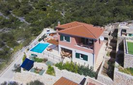 Houses with pools for sale in Dalmatia. Furnished villa with a garden, a swimming pool and a parking, 50 meters from the beach, Trogir, Croatia