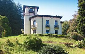 Luxury houses for sale in Piedmont. Ancient 19th century villa with private garden and panoramic views of the lake and the Borromeo Islands, in the Alpine region, Stresa, Italy