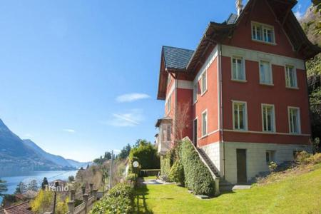 Houses for sale in Laglio. Renovated ancient villa with a view of Lake Como, a fireplace and a big garden
