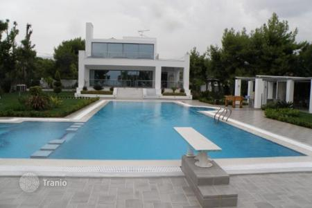 Luxury houses with pools for sale in Greece. Three-storey villa on the beachfront in Attica