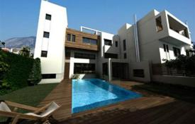 5 bedroom apartments for sale in Attica. Modern three-level maisonette with a garden, a swimming pool and a parking under construction, Alimos, Attica, Greece
