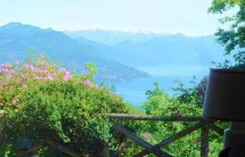 Property for sale in Gignese. Lake Maggiore. A delightful detached 4 bedroom house with stunning lake views