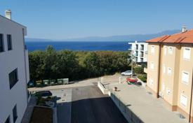 Coastal residential for sale in Rožmanići. Comfortable new building with spacious apartments, at 200 meters from the sea