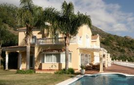 Luxury 3 bedroom houses for sale in Spain. Spacious villa with a private garden, a pool, a garage and a terrace with sea and mountain views, Marbella, Spain