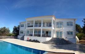 Houses with pools for sale in Faro. New villa with a pool, a tennis court and ocean views, Albufeira, Portugal