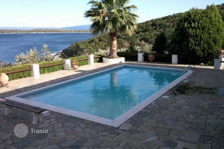 Luxury property for sale in Greece. The estate with two large plots with a villa, a guest house, a swimming pool and a private beach, Amaliapoli, Greece. Possible bargain!