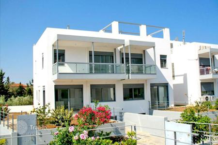 Townhouses for sale in Administration of the Peloponnese, Western Greece and the Ionian Islands. Three-level townhouse with sea and mountain views, 2 steps from the beach in Loutraki