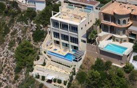 Houses for sale in Calvia. Stylish beachfront villa with two swimming pools and a winter garden, Port Adriano, Mallorca, Spain